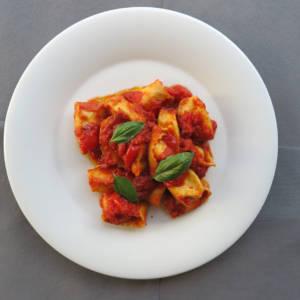 Handmade Ravioli stuffed with Ricotta, Tomato Cherry and Basil Sauce